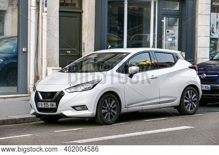 Versailles, France - September 15, 2019: White Compact Car Nissan Micra K14 In The City Street.
