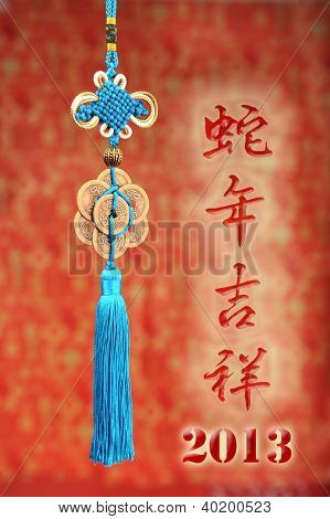 Chinese calligraphy mean happy the snake of year,Lucky knot for Chinese new year greeting