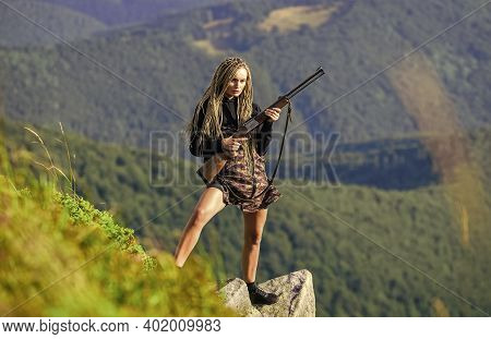 Sexy Warrior. Woman Attractive Long Hair Pretty Face Hold Rifle For Hunting. Amazon Legendary Race O