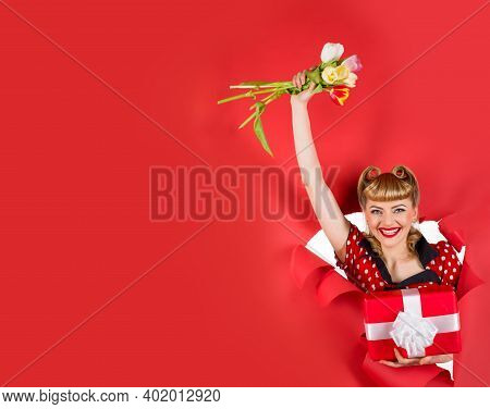 Advertising. Pin Up Girl With Flowers. Smiling Retro Woman Hold Flowers Through Hole In Paper. Woman