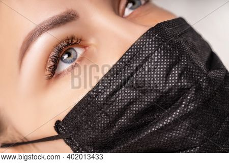 Eyelash Extension Procedure. Beautiful Woman With Extreme Long False Eyelashes. Makeup, Cosmetics. B