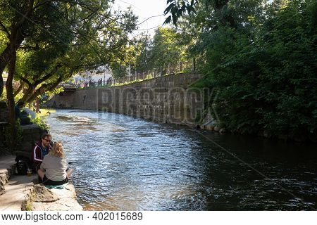 Vilnius, Lithuania - July 7, 2017: Unidentified People Relax On The Embankment Of Vilnele River In U