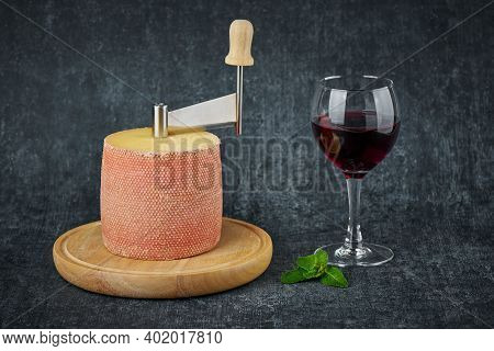 Delicious Tete De Moine Cheese On Girolle,wine Glass And Mint Leaves,gourmet Concept