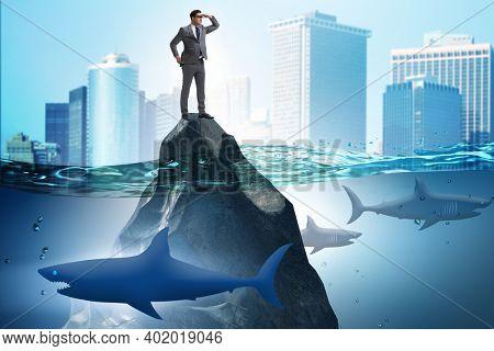 Businessman desperate on desert island in business concept