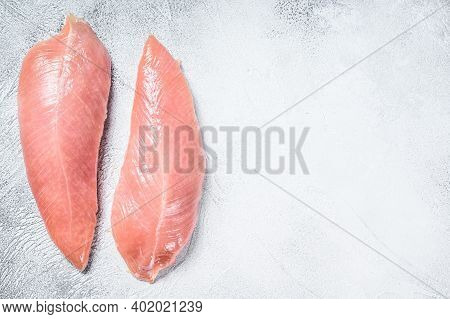 Raw Turkey Steaks. Breast Fillet. White Background. Top View. Copy Space