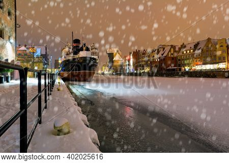 Winter Scenery Of Motlawa River And Gdansk At Night, Poland, Europe.