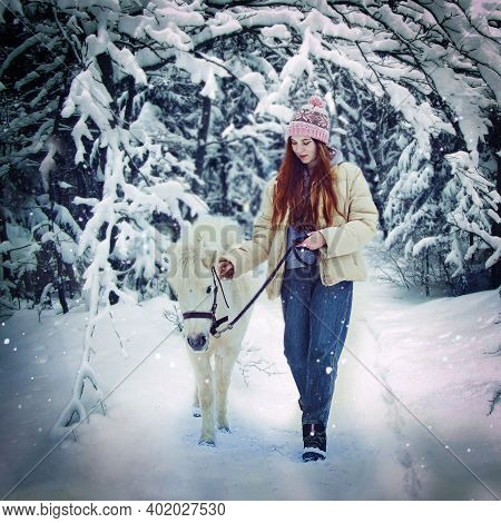 Girl With Long Brown Hair And White Pony Full Body Portrait On Winter Snowy Background