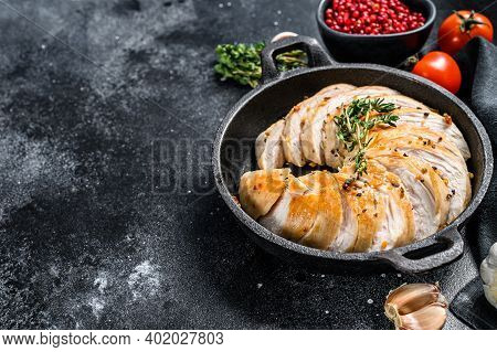 Grilled Sliced Turkey Steaks In A Pan. Breast Fillet. Black Background. Top View. Copy Space