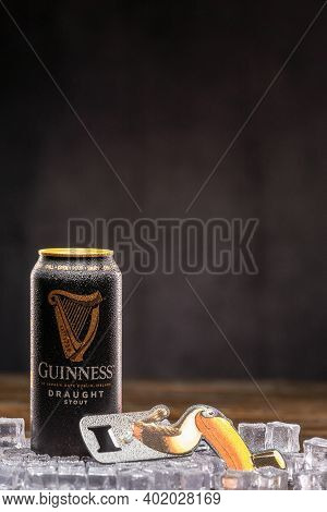 Guinness Draught Can On Ice And Guinness Toucan Bottle Opener. Uk, Bedford, January 4, 2021