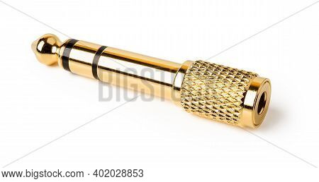 Golden Trs Adapter Isolated On White Background. Gold Plated Stereo Jack Adapter For All Types Of Wi