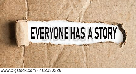 Everyone Has A Story, Text On White Paper On Ripped Paper Background