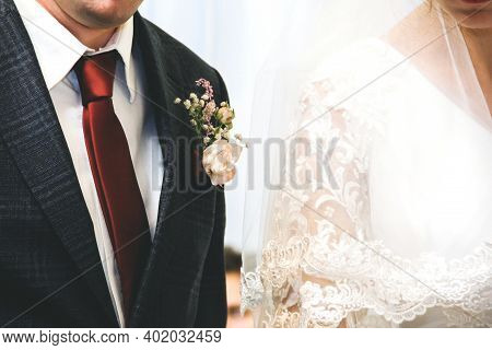 Bride And Groom Together Close Up. Wedding Dress And Red Tie.