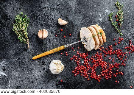 Grilled Sliced Turkey Steaks. Breast Fillet. Black Background. Top View