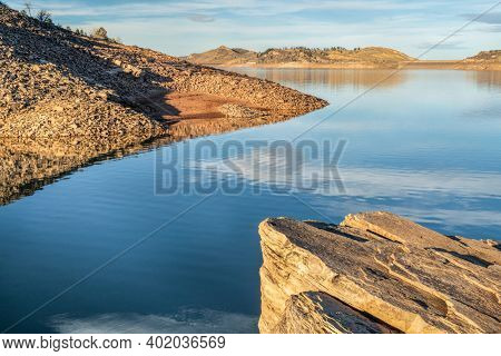 fall or winter scenery of mountain lake at foothills of Rocky Mountains in afternoon light, Horsetooth Reservoir - a popular recreational area in northern Colorado