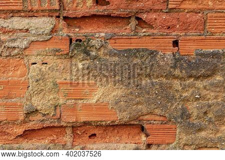 Fragment Of An Old Damaged Weathered Brick Wall With Rot And Mold Close Up