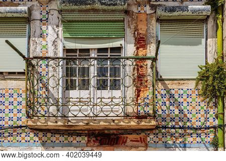 A closeup of an old building front balcony, Lisbon architecture, Portugal