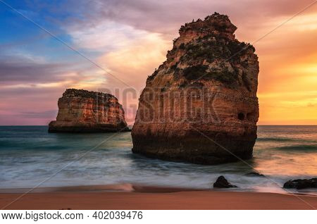 Sunset landscape with views of the cliffs and the coast near Ferragudo. Portugal