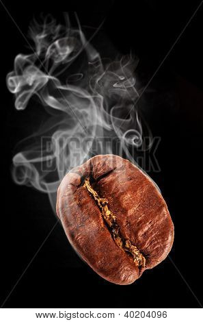 Flying coffee bean in smoke, isolated on black background