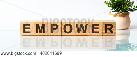 Empower Word Written On Wood Block. Empower Motivation Text On Wooden Blocks Business Concept White