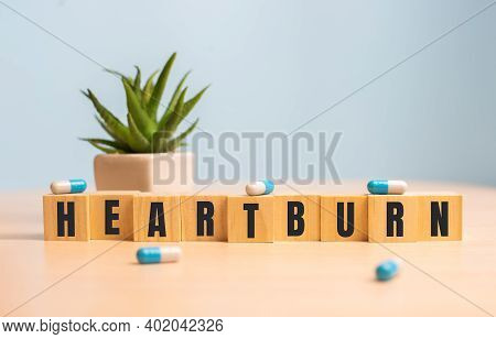 Heartburn Word Concept On Wooden Cubes On Blue