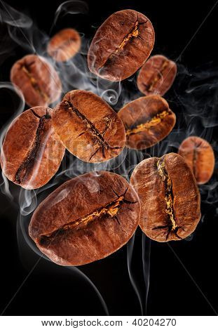 Flying coffee beans in smoke, isolated on black background