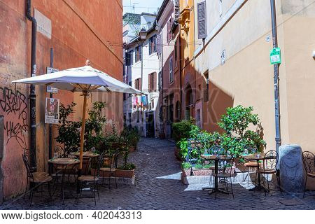 Trastevere / Rome / Italy - July 04, 2019: Charming And Colorful Streets Of Trastevere In Rome