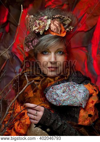 Fashion portrait of romantic senior woman with bright hairstyle, art dress. Creative concept Once upon a time in fantasy.