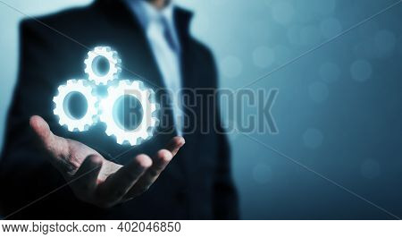 Hand Showing Icon Gear Process. Concept Of Automation Software Technology Process System Business