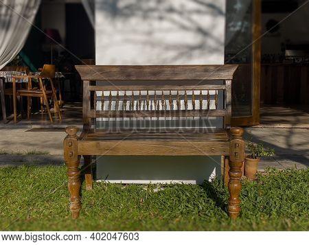 Brown Wooden Bench In Garden, Stock Photo