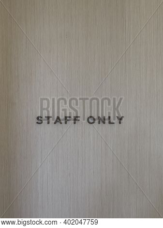Staff Only Word On Empty Wall Background, Stock Photo