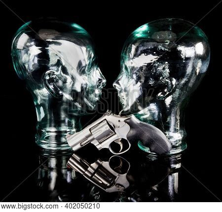 357  Magnum Revolver With Glass Cyborg Looking Heads.