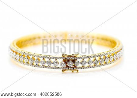Close up shot of gold and real diamond bracelet