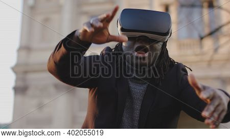 Scared African American Man With Vr Headset Gesturing Like In Free Fall. High Quality Photo