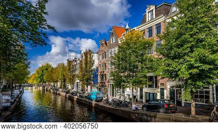 Amsterdam, Noord Holland, The Netherlands - Oct. 3 2018: Historic Houses, Parked Cars And Bikes  Alo