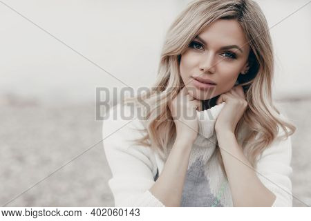 Young Beautiful Blonde Caucasian Woman Walks Alone Enjoying The Spring Weather. Beautiful Girl, Outd