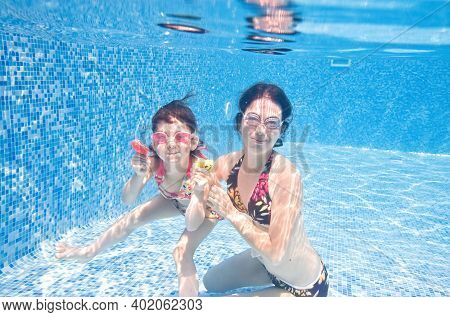 Family Swims In Pool Underwater, Happy Active Mother And Child Have Fun Under Water, Fitness And Spo