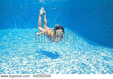 Child Swims Underwater In Swimming Pool, Little Active Girl Dives And Has Fun Under Water, Kid Fitne