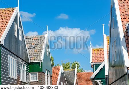Typical Dutch Family Houses, Traditional Village Historic Architecture Of Marken Island, Netherlands