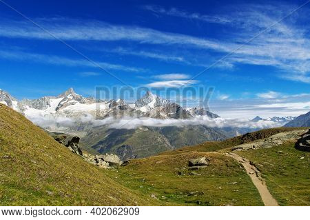View Of Hiking Trail In Swiss Alps, Zermatt Mountains Area Near Matterhorn Peak In Summer, Switzerla