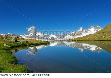 Beautiful Swiss Alps Landscape With Stellisee Lake And Matterhorn Mountain Reflection In Water, Summ