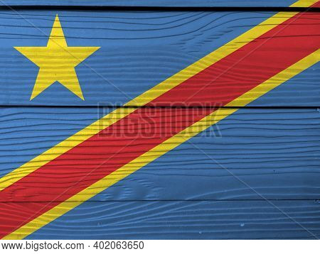 Flag Of Dr Congo On Wooden Wall Background. Grunge Dr Congo Flag Texture, Sky Blue Field With Diagon
