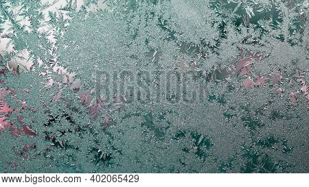 Ice And Frost On The Window. Tinted Winter Sunset. Blue-green And Pink Wallpaper Or Background. Froz