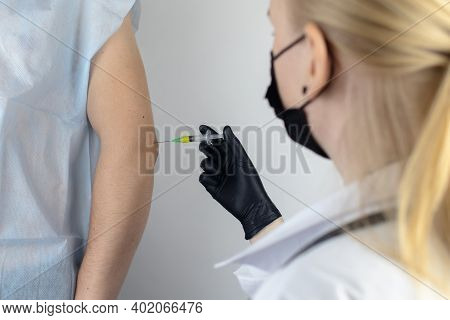 An Orthopedic Surgeon Gives An Injection In The Elbow. Treatment Of Osteoarthritis With Hormonal Dru