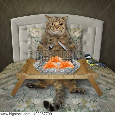 A Beige Cat Is Eating Sushi From A Wooden Tray In The Bed At Home.