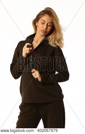Blond Woman In Black Pantsuit Close Up Portrait Isolated On White
