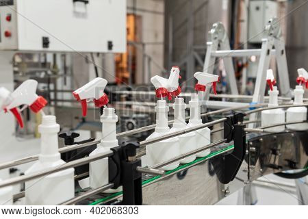 Plastic Bottles, Sprayers, On The Automated Conveyor Line On The Chemical Factory. Cleaners Producti