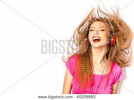 Cute Curly Blonde Girl Listening To Music On Big Red Headphones Isolated On White