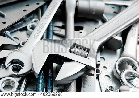 Metal Tools. Metal Style. Wrench And Metal Tools On The Scratched Metal Background.