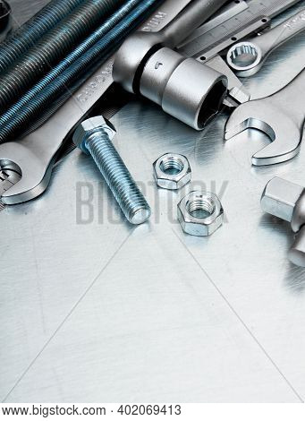Metal Working Tools. Metal Style. Metal Tools And Fixing Elements On The Scratched Metal Background.