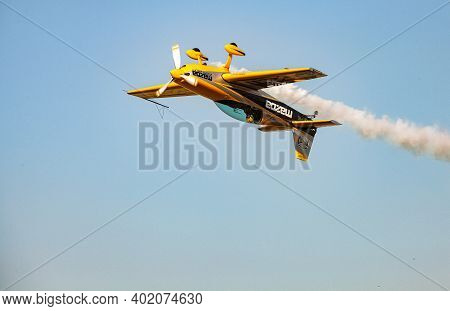 Single Small Propeller Airplane Performing Aerobatics With Smoke Trails